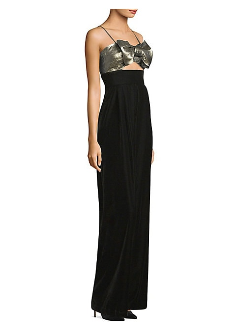 """Image of Alluring velvet jumpsuit in bow metallic detail. Sweetheart neckline. Spaghetti straps. Concealed back zip. Cutout waist. Wide-leg silhouette. Inseam, about 35"""".Polyester/cotton/metallic. Dry clean. Made in USA. Model shown is 5'10"""" (177cm) wearing size S"""