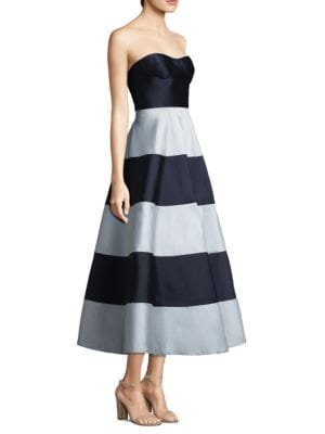 """Image of Striped A-line dress in sheen finish. Strapless. Sweetheart neckline. Concealed back zip closure. About 50"""" from shoulder to hem. Polyester/nylon/elastane. Dry clean. Imported. Model shown is 5'10"""" (177cm) and wearing US size 4."""