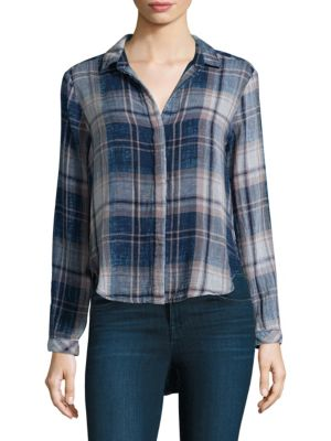 """Image of Cotton button-front shirt in classic plaid print. Fold-over collar. Long sleeves. Concealed button-front. About 25"""" from shoulder to hem. Cotton. Machine wash. Made in USA. Model shown is 5'10"""" (177cm) and wearing US size Small."""