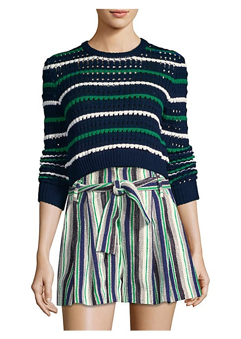 """Image of Cropped open knit sweater in striped design. Roundneck. Long sleeves. Pullover style. About 17"""" from shoulder to hem. Organic cotton. Dry clean. Imported. Model shown is 5'10"""" (177cm) wearing US size Small."""