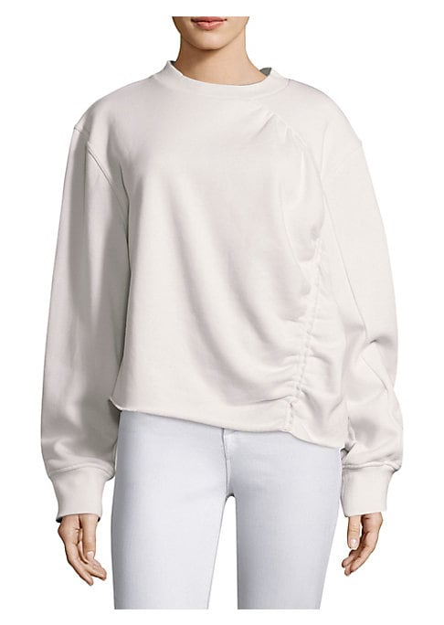 """Image of Cotton sweatshirt with shirred detailing. Crewneck. Long sleeves. Pullover style. About 25"""" from shoulder to hem. Cotton. Machine wash. Imported. Model shown is 5'10"""" (177cm) wearing size Small."""