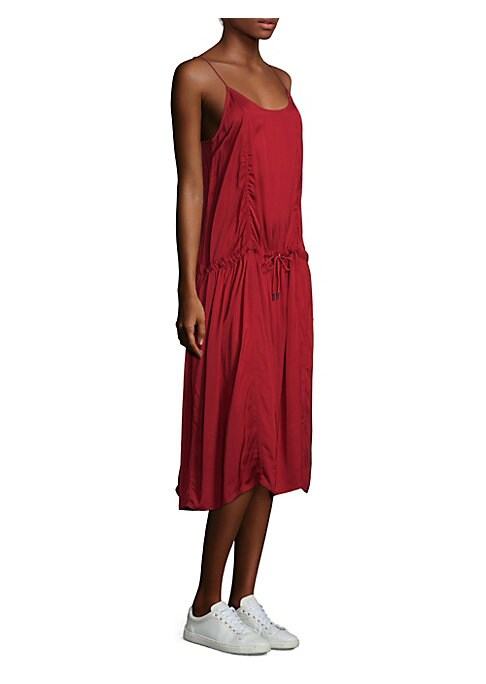 """Image of Shirred drawstring dress in sleeveless silhouette. Roundneck. Sleeveless. Drawstring waist. Pullover style. About 50"""" from shoulder to hem. Viscose. Hand wash. Made in USA. Model shown is 5'10"""" (177cm) wearing US size 4."""
