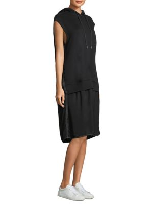"""Image of Sleeveless hoodie dress with contrast stitching. Attached drawstring hood. Sleeveless. Pullover style. About 47"""" from shoulder to hem. Cotton. Contrast: Viscose. Hand wash. Imported. Model shown is 5'10"""" (177cm) and wearing US size Small."""