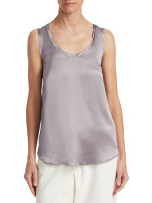 """Image of Simple tank crafted in luxurious silk. Roundneck. Sleeveless. Pullover style. About 25"""" from shoulder to hem. Silk/elastane. Dry clean. Made in Italy. Model shown is 5'10"""" (177cm) and wearing US size Small."""