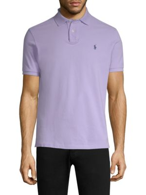 "Image of Pique polo with weathered finish. Polo collar. Short sleeves. Three-button placket. About 27"" from shoulder to hem. Cotton. Machine wash. Imported."