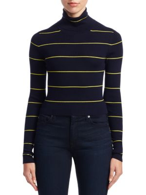 "Image of Slim cropped sweater. Turtleneck. Long sleeves. Pullover style. Cropped silhouette. About 20"" from shoulder to hem. Wool. Dry clean. Made in Italy. Model shown is 5'10"" (177cm) wearing US size Small."