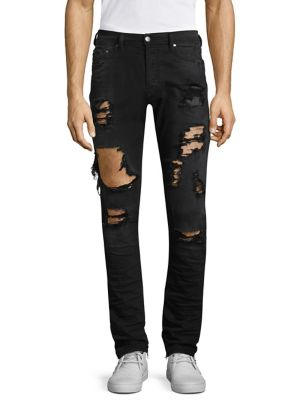 """Image of Stretch-cotton denim with ripped distressed finish in a skinny fit. Belt loops. Zip fly with button closure. Five-pocket style. Rise, about 10"""".Inseam, about 32"""".Leg opening, about 10"""".Cotton/elastane. Machine wash. Imported."""