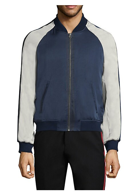 "Image of All-around jacket with contrasting detail on sleeves. Stand collar. Long raglan sleeves. Rib-knit at cuffs and hem. Exposed front zip. Side slip pockets. Lined. About 26"" from shoulder to hem. Polyester. Hand wash. Imported."
