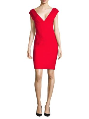 """Image of V-neck dress with back cutout detail.V-neck. Cap sleeves. Concealed back zip closure. About 36"""" from shoulder to hem. Viscose/polyamide/elastane. Dry clean. Made in Italy. Model shown is 5'10"""" (177cm) wearing US size 4. ."""