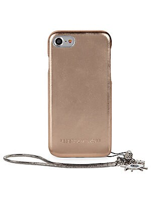 "Image of Add a sophisticated touch to your iPhone with metallic leather case Wrist strap, 6.5"" drop 3""W x 5.5""H Fits iPhone 7 Leather Imported. Handbags - Contemporary Handbags. Rebecca Minkoff. Color: Metallic Bronze."