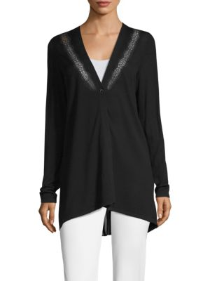 """Image of Lace embroidered cardigan. Deep V-neck. Long sleeves. Button down. Back vent. Merino wool. Dry clean. Imported. Model shown is 5'10"""" (177cm) and wearing US Small."""
