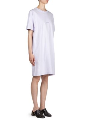 "Image of Cotton T-shirt dress with front logo detail. Roundneck. Short sleeves. Pullover style. About 37"" from shoulder to hem. Cotton. Machine wash. Imported. Model shown is 5'10"" (177cm) and wearing US size Small."