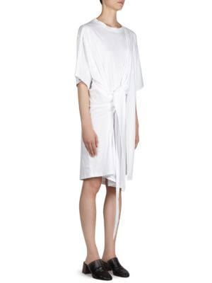 "Image of Cotton T-shirt dress with front tie detail. Roundneck. Short sleeves. Pullover style. About 40"" from shoulder to hem. Cotton. Machine wash. Made in Italy. Model shown is 5'10"" (177cm) and wearing US size Small."