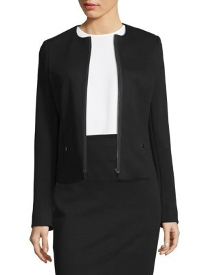 "Image of Collarless long sleeve topper jacket. Roundneck. Long sleeves. Zip-front. About 22"" from shoulder to hem. Polyamide/viscose/elastane. Dry clean. Imported. Model shown is 5'10"" (177cm) and wearing US size 4."