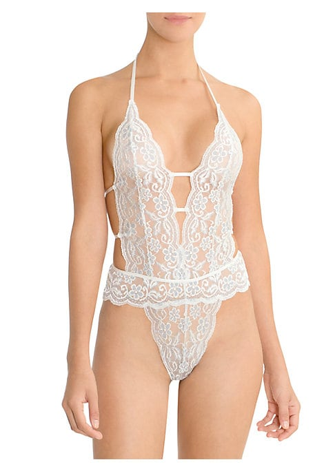 Image of Cutaway details elevate sexy stretch lace teddy. Plunging neckline. Adjustable halter strap. Strappy sides and back. Nylon/rayon/spandex. Hand wash. Imported.