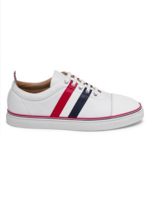 Image of Casual sneakers finished with striped design. Leather, polyester, rubber and cotton upper. Round toe. Lace-up vamp. Back pull tab. Rubber sole. Made in Italy.