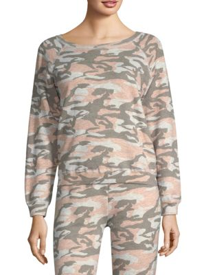 """Image of Raglan sleeve pullover in vintage camouflage print. Roundneck. Long raglan sleeves. Pullover style. About 23"""" from shoulder to hem. Polyester/rayon/cotton. Machine wash. Made in USA. Model shown is 5'10"""" (177cm) wearing US size S."""