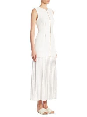 """Image of Maxi dress finished with feminine pleats and tweed. Crewneck. Sleeveless. Concealed back zip. Seamed waist. Side slit. Box pleats. About 57"""" from shoulder to hem. Cotton. Dry clean. Imported. Model shown is 5'10"""" (177cm) wearing US size 4."""