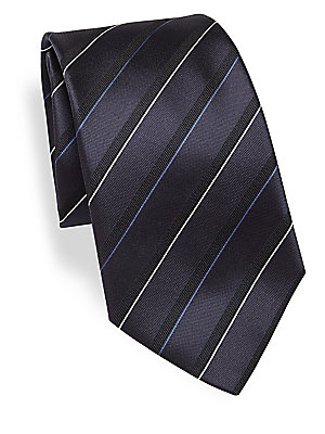 Image of Distinguished silk tie with textured stripes Width, 3.5 Silk Dry clean Made in Italy. Men Luxury Coll - Armani Neckwear. Emporio Armani. Color: Dark Blue.