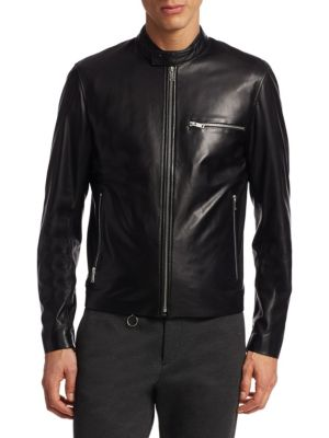 "Image of Refined leather motorcycle jacket with zip details. Stand collar with snap tab. Long sleeves. Zip cuffs. Zip front. Chest zip pocket. Waist zip pockets. About 27"" from shoulder to hem. Leather. Dry clean by leather specialist. Imported."
