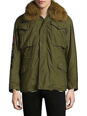 Image of Luxe fur collar and lining elevates enduring military coat Oversized spread collar with attached fur Shoulder epaulettes Long sleeves Button cuffs Zip front with snapped storm placket Chest flap patch pockets Waist flap pockets Interior drawstring waist D