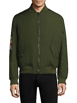 Image of Coyote fur-lined bomber jacket styled with embroidered patches. Baseball collar Long sleeves Zip front Snap flap pockets Sleeve pocket Ribbed collar, cuffs and hem Polyamide/polyurethane Fur type: Natural coyote Fur origin: USA Made in Italy SIZE & FIT Ab