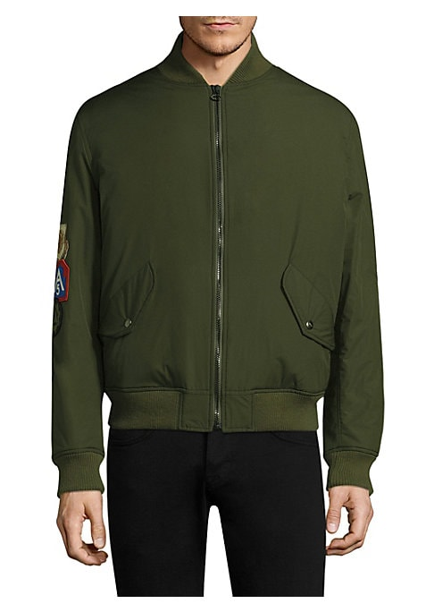 """Image of Bright patches elevate studied classic bomber. Baseball collar. Long sleeves. Zip front. Snap flap pockets. Sleeve pocket. Ribbed collar, cuffs and hem. About 25"""" from shoulder to hem. Polyamide/polyurethane. Made in Italy."""