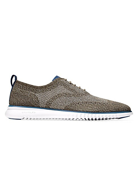 Image of Casual leather sneakers adorned with perforated design. Leather upper. Round toe. Lace-up vamp. Back pull tab. Rubber sole. Imported.