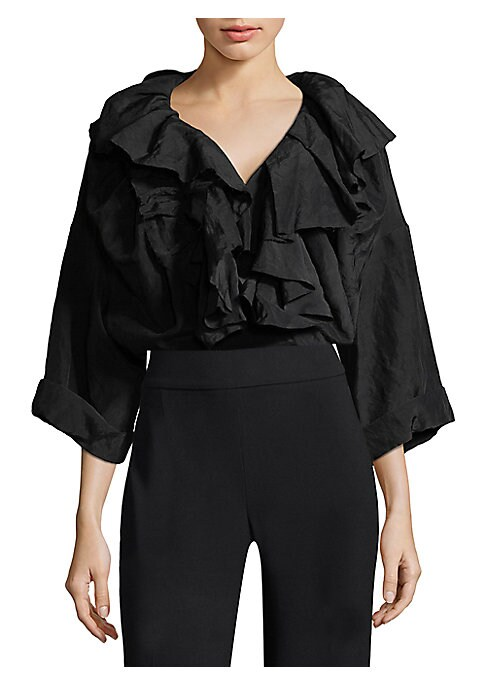 """Image of Linen top accented with ruffle detailing.V-neck. Three-quarter sleeves. Pullover style. About 25"""" from shoulder to hem. Viscose/linen. Dry clean. Imported. Model shown is 5'10"""" (177cm) wearing US size Small."""
