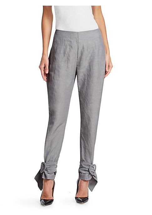 Image of These fanciful pants feature a crinkled aesthetic that exudes refined edge. Designed with adjustable buckled leg openings, this item is modern in its utilitarianism. Seamed waist. Concealed back zip. Crinkled crepe finish. Viscose/linen. Dry clean. Import