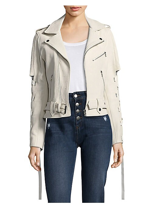 "Image of Relaxed-fit leather moto jacket. Notch collar. Long lace-up sleeves. Exposed front zip. Snap epaulets. Zip cuffs. Chest zip pocket. Waist zip pockets. Belted hem. About 24"" from shoulder to hem. Leather. Dry clean by leather specialist. Imported. Model sh"