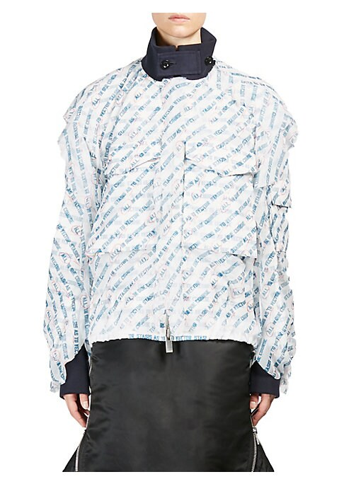 """Image of Allover print adorns blouson. Stand collar with tab button closure. Long sleeves. Flap sleeve pocket. Chest flap pockets. Exposed front zip. About 28"""" from shoulder to hem. Polyester/cotton. Dry clean. Imported. Model shown is 5'10"""" (177cm) wearing size S"""
