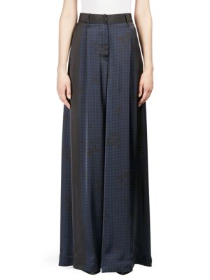 """Image of Check floral print adorns wide leg pants. Belt loops. Banded waist. Zip fly with hook-and-eye closure. Rise, about 13"""".Inseam, about 35"""".Polyester/cupro. Dry clean. Imported. Model shown is 5'10"""" (177cm) wearing US size Small."""