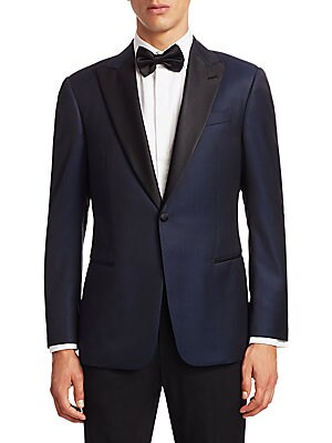 Image of From the Saks IT LIST THE JACKET The wear everywhere layer that instantly dresses you up. Wool-blend jacket with an allover dotted pattern Peak lapels with buttonhole Long sleeves Buttoned cuffs Button front Chest welt pocket Waist welt pockets Dual back