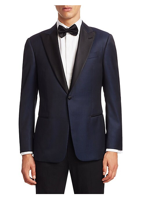 Image of From the Saks IT LIST. THE JACKET. The wear everywhere layer that instantly dresses you up. Wool-blend jacket with an allover dotted pattern. Peak lapels with buttonhole. Long sleeves. Buttoned cuffs. Button front. Chest welt pocket. Waist welt pockets. D