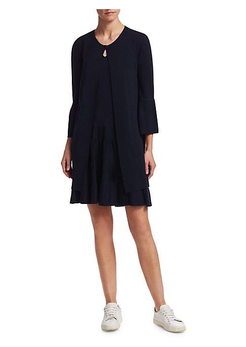 """Image of Classic cardigan crafted from luxurious fabrics. Roundneck. Long sleeves. Rib-knit at neck, cuffs and hem. Button front. Waist slip pockets. About 33"""" from shoulder to hem. Wool/silk/cashmere. Dry clean. Made in Italy. Model shown is 5'10"""" (177cm) wearing"""