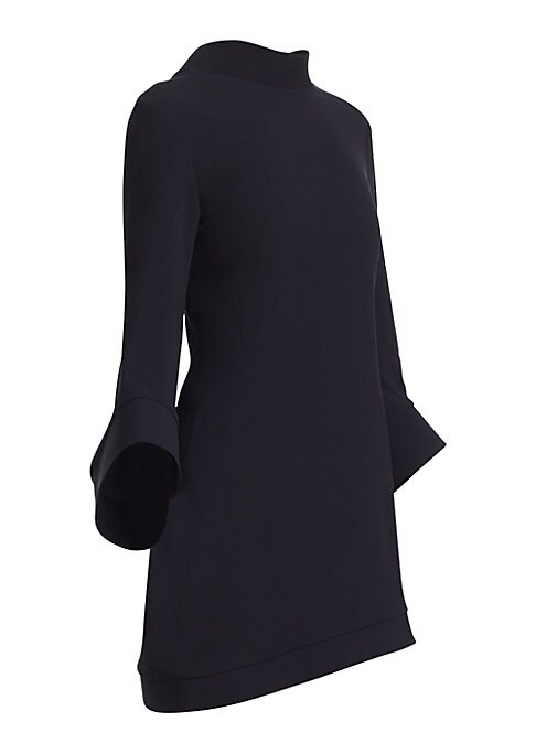 "Image of Dramatic sleeves and an asymmetric hem shape this modern mini dress. Mockneck. Long bell sleeves. Asymmetric hem. Concealed back zip closure. Viscose/spandex. Dry clean. Made in USA. SIZE & FIT. About 34"" from shoulder to hem. Model shown is 5'10"" (177cm)"