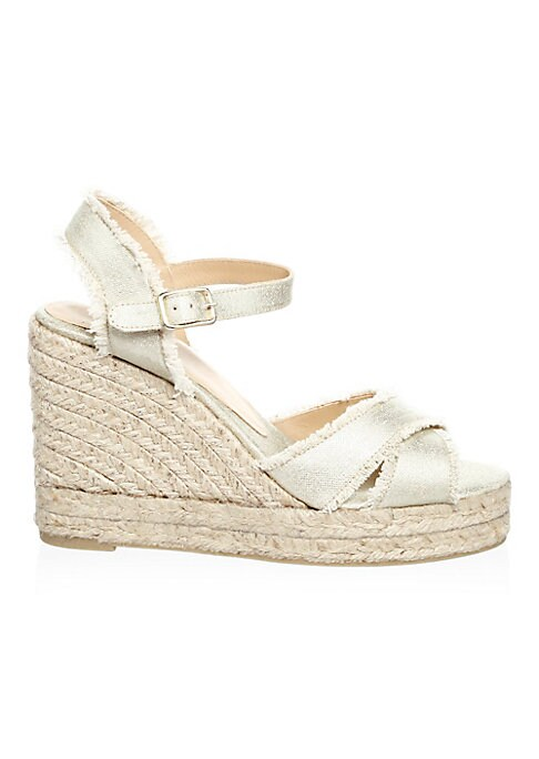"""Image of Statement espadrille raffia wedge sandals with metallic fringe details. Wedge heel, 5"""" (100mm).Cotton upper. Open toe. Buckle ankle-strap. Leather lining. Rubber sole. Imported."""