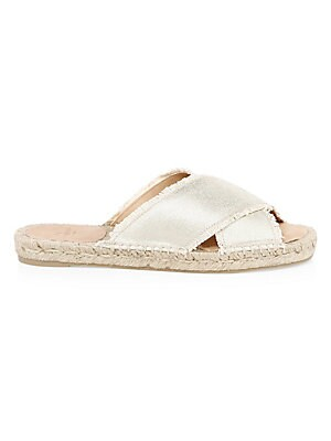 Image of Chic espadrille slides flaunt metallic strap finish Textile upper Slip-on style Open toe Textile lining Rubber sole Made in Spain. Women's Shoes - Contemporary Womens Shoe. Castañer. Color: Champagne. Size: 35 (4.5).