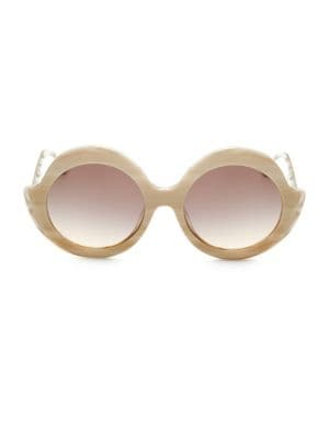 Image of Chic horn elevates oversized round sunglasses.55mm lens width; 20mm bridge width; 135mm temple length.100% UV protection. Gradient lenses. Acetate. Imported.