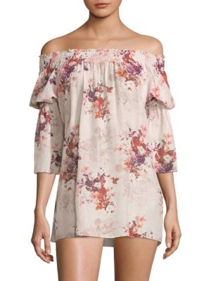 """Image of Soft cotton-blend top with allover floral print. Off-the-shoulder neckline. Three-quarter shirred sleeves. About 30"""" from shoulder to hem. Cotton/silk. Hand wash. Imported. Model shown is 5'10"""" (177cm) wearing a size Small."""