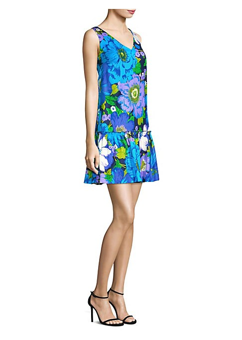"""Image of V-neck dress in lively floral print. V-neck. Sleeveless. Concealed back zip closure. About 34"""" from shoulder to hem. Rayon/cotton/spandex. Dry clean. Imported. Model shown is 5'10"""" (177cm) wearing US size 4. ."""