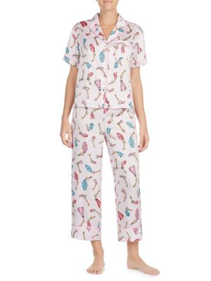 "Image of Short-sleeve sleepwear collection with a fresh print. Polyester. Machine wash. Imported. TOP. Notch collar. Short sleeves. Button front. Chest pocket. Contrast piping. About 24"" from shoulder to hem. PANTS. Pull-on style. Inseam, about 25""."