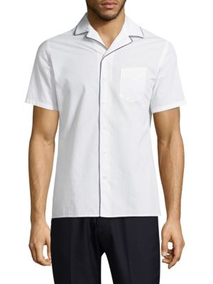 """Image of Button-front shirt with contrast color piping. Notch collar. Short sleeves. Front patch pocket. Concealed button-front. About 29"""" from shoulder to hem. Cotton. Machine wash. Imported."""