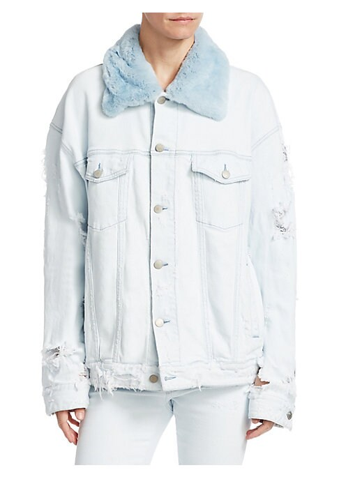"""Image of Distressed denim jacket with contrast fur collar. Fur collar. Long sleeves. Buttoned barrel cuffs. Button front. Chest buttoned flap pockets. Button tab hem. About 26"""" from shoulder to hem. Cotton. Fur type: Orylag. Fur origin: France. Made in Italy. Mode"""