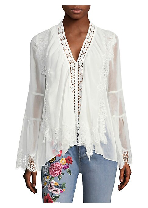 """Image of Blouse with delicate lace trim.V-neck. Long flare sleeves. Pullover style. About 24"""" from shoulder to hem. Polyester. Contrast: Nylon. Dry clean. Imported. Model shown is 5'10"""" (177cm) wearing US size Small."""