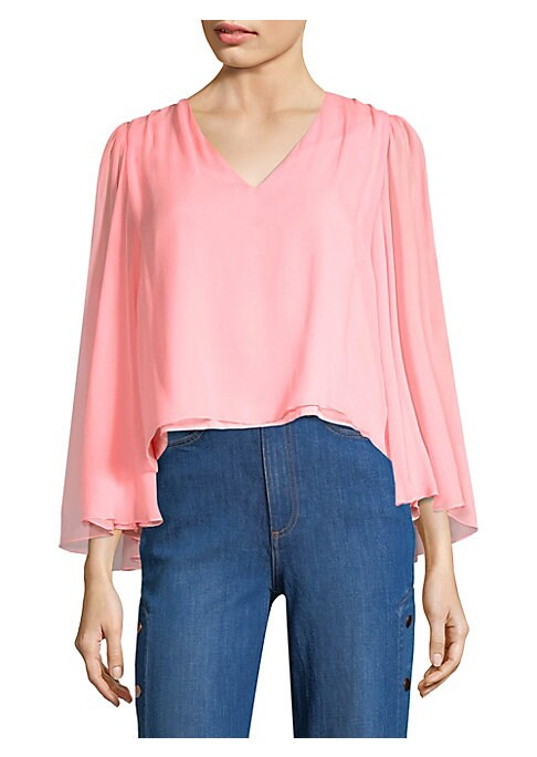 """Image of Cropped blouse designed in lavish silk.V-neck. Long sleeves. Pullover style. About 23"""" from shoulder to hem. Silk. Dry clean. Imported. Model shown is 5'10"""" (177cm) wearing US size Small."""