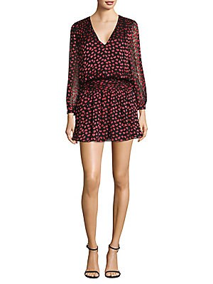 """Image of Alluring dress designed in heart print V-neck Long sleeves Exposed back zip About 35"""" from shoulder to hem Viscose/silk Dry clean Imported Model shown is 5'10 (177cm) wearing US size 4. Contemporary Sp - Alice + Olivia. Alice + Olivia. Color: Mini Hearts"""