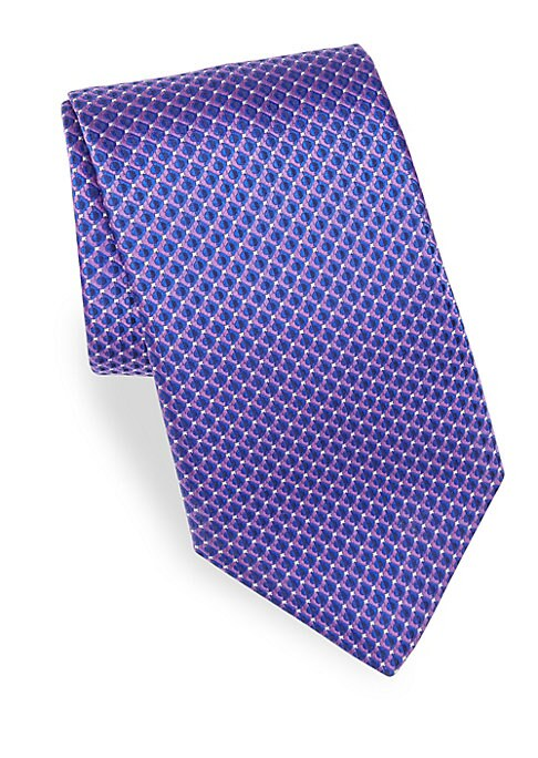 "Image of Allover circular print adds modern element to silk tie.3"" wide. Silk. Dry clean. Made in Italy."