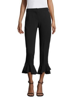 "Image of From the Nights On Broadway Collection. Chic pants with ruffled leg openings.V-neck. Zip fly with concealed closure. Side slant pockets. Back welt pocket. Lined. Inseam, about 28""-30"".Polyester/viscose/cotton/elastane. Dry clean. Made in USA of imported f"
